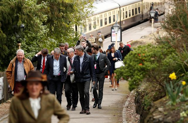 Horse Racing - Cheltenham Festival - Cheltenham Racecourse, Cheltenham, Britain - March 14, 2018 Racegoers arrive at Cheltenham Racecourse railway station before the racing Action Images via Reuters/Matthew Childs