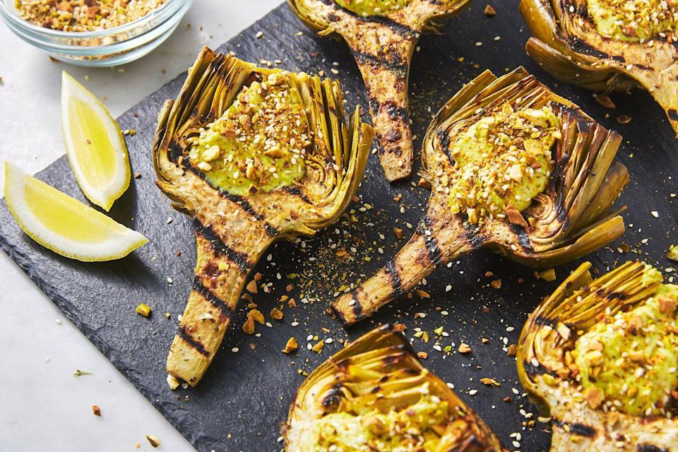 """<p>The cool, green pistachio-yogurt cream adds a little bit of spice and crunch.<br></p><p>Get the recipe from <a href=""""https://www.delish.com/cooking/recipe-ideas/a27198662/grilled-artichoke-recipe/"""" rel=""""nofollow noopener"""" target=""""_blank"""" data-ylk=""""slk:Delish"""" class=""""link rapid-noclick-resp"""">Delish</a>.</p>"""