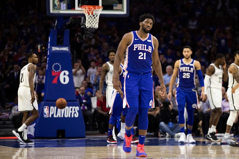 Lingering pain in his left knee has sidelined Joel Embiid for Game 3. (AP)