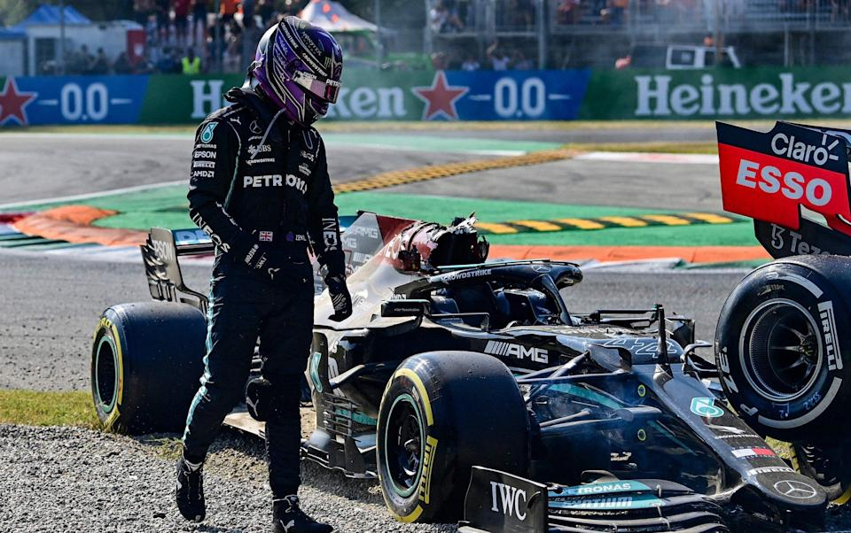 Mercedes' British driver Lewis Hamilton gets out of his car following a collision with Red Bull's Dutch driver Max Verstappen (unseen) during the Italian Formula One Grand Prix at the Autodromo Nazionale circuit in Monza, on September 12, 2021. - AFP