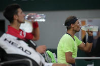 Spain's Rafael Nadal, right, and Serbia's Novak Djokovic drink during a break in their semifinal match of the French Open tennis tournament at the Roland Garros stadium Friday, June 11, 2021 in Paris. (AP Photo/Christophe Ena)