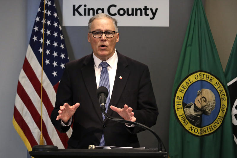 FILE - In this March 16, 2020, photo Washington Gov. Jay Inslee speaks about the coronavirus outbreak in Seattle. Inslee ordered all bars, restaurants, entertainment and recreation facilities to temporarily close to fight the spread of COVID-19 in the state with by far the most deaths in the U.S. from the disease. (AP Photo/Elaine Thompson, Pool)