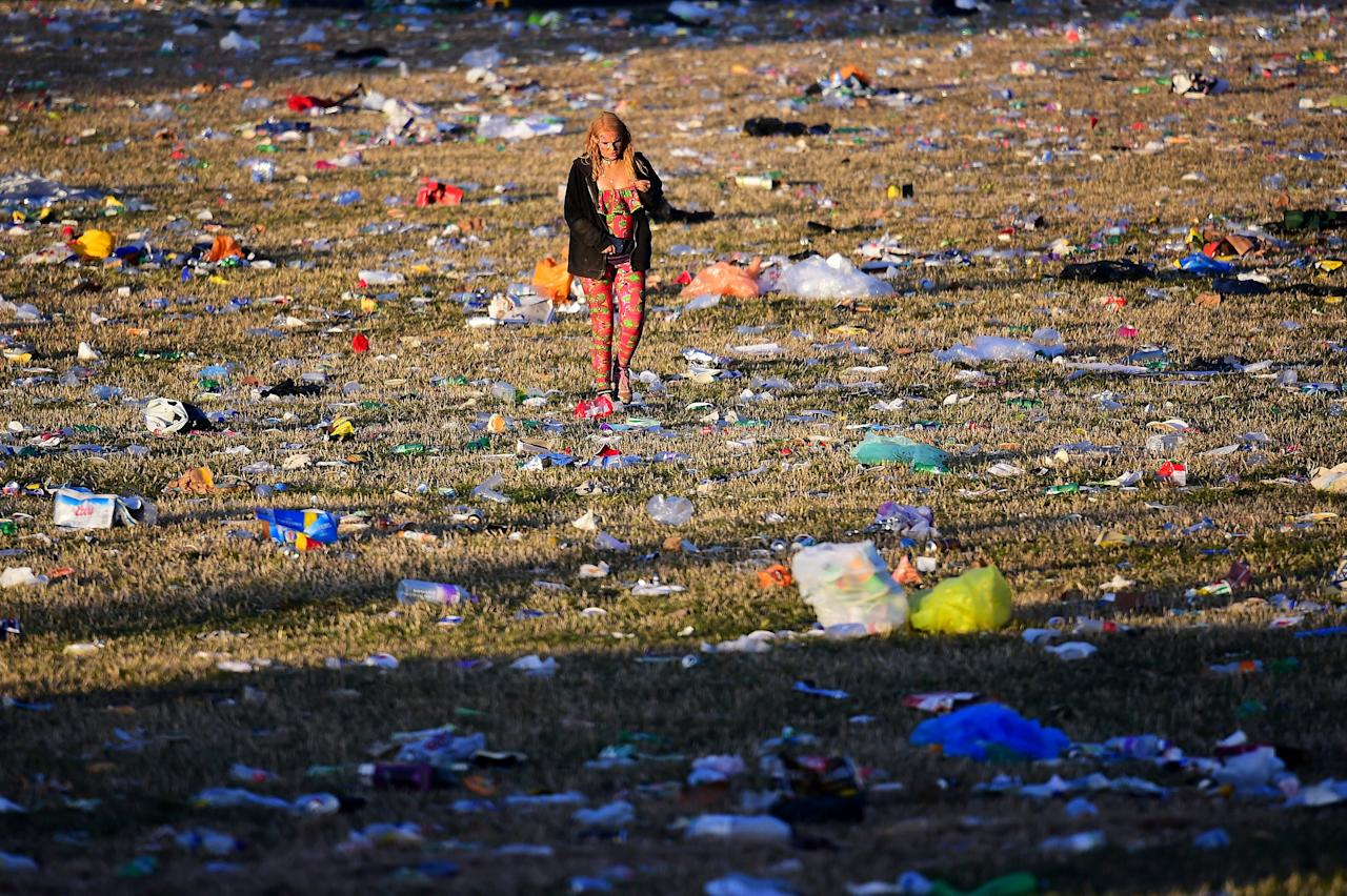 Revellers and detritus are seen near the Pyramid Stage at Worthy Farm in Somerset during the Glastonbury Festival in Britain, June 26, 2017. REUTERS/Dylan Martinez     TPX IMAGES OF THE DAY