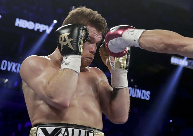 Canelo Alvarez dodges a jab from Gennady Golovkin during the second round of a middleweight title boxing match, Saturday, Sept. 15, 2018, in Las Vegas. (AP Photo/Isaac Brekken)