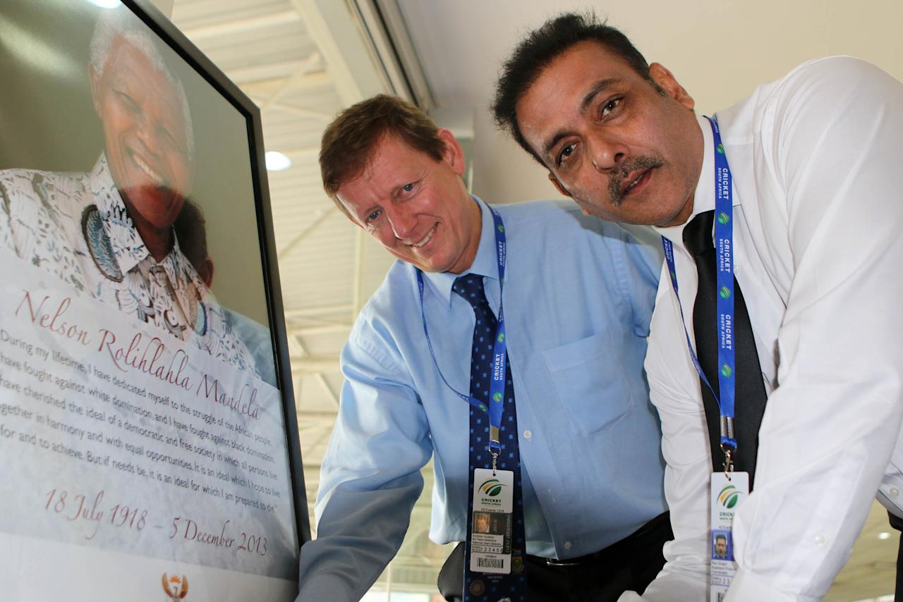 DURBAN, SOUTH AFRICA - DECEMBER 08: Andrew Hudson ( l) and Ravi Shastri sign the book of Condolences for Nelson Mandela during the 2nd Momentum ODI match between South Africa and India at Sahara Stadium Kingsmead on December 08, 2013 in Durban, South Africa. (Photo by Anesh Debiky/Gallo Images/Getty Images)