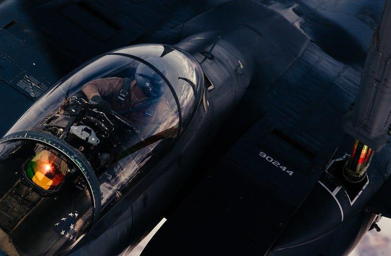 A F-15E Strike Eagle refuels from a 908th Expeditionary Aerial Refueling Squadron KC-10 Extender in support of Operation Inherent Resolve, March 17, 2019.