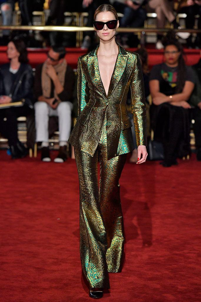 <p>Model wears a green metallic pantsuit at the fall 2018 Christian Siriano show. (Photo: Getty Images) </p>