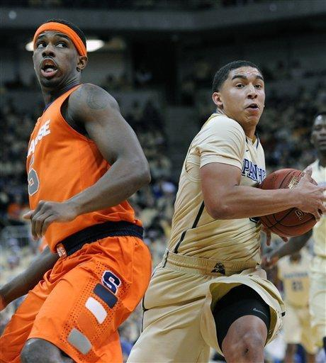 Pittsburgh James Robinson, right, drives to the basket past Syracuse C.J. Fair, left, during the first half of an NCAA basketball game in Pittsburgh, Saturday, Feb. 2, 2013. (AP Photo/John Heller)