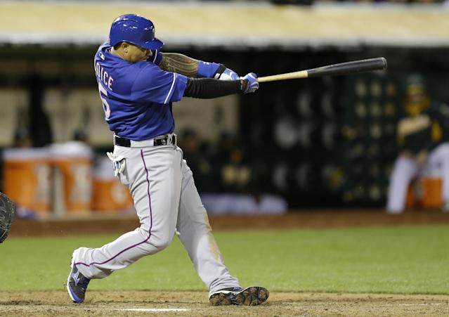 Texas Rangers' Michael Choice swings for an RBI single off Oakland Athletics' Luke Gregerson in the ninth inning of a baseball game Tuesday, April 22, 2014, in Oakland, Calif. (AP Photo/Ben Margot)
