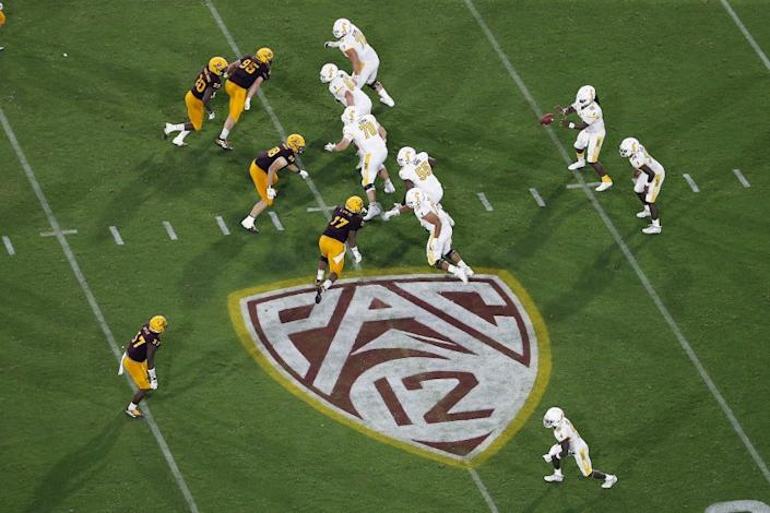 FILE - This Thursday, Aug. 29, 2019, file photo, shows the Pac-12 logo during the second half of an NCAA.