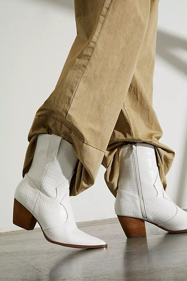 """<br><br><strong>Free People</strong> Vegan Daley Ankle Boots, $, available at <a href=""""https://www.freepeople.com/uk/shop/vegan-daley-ankle-boots/?recommendation=dyrectray-ViewedWith&color=010&type=REGULAR&quantity=1"""" rel=""""nofollow noopener"""" target=""""_blank"""" data-ylk=""""slk:Free People"""" class=""""link rapid-noclick-resp"""">Free People</a>"""