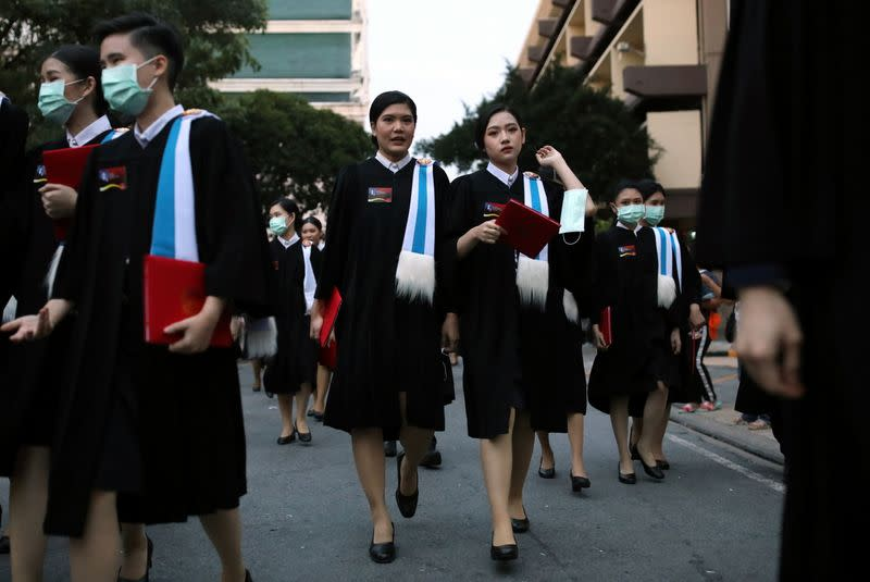 Students attend their graduation ceremony led by King Maha Vajiralongkorn, at Thammasat University in Bangkok