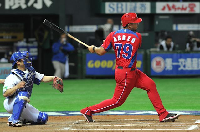 Cuba's Jose Abreu (R) bats as catcher Diego Franca (L) of Brazil looks on during the sixth inning of their first-round Pool A game in the World Baseball Classic tournament in Fukuoka on March 3, 2013. AFP PHOTO / KAZUHIRO NOGIKAZUHIRO NOGI/AFP/Getty Images