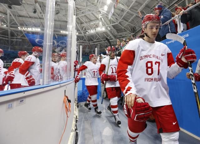 Members of the Olympic Athletes from Russia hockey team leave the ice dejected after losing their opener against Slovakia at the Winter Olympics. (Reuters)