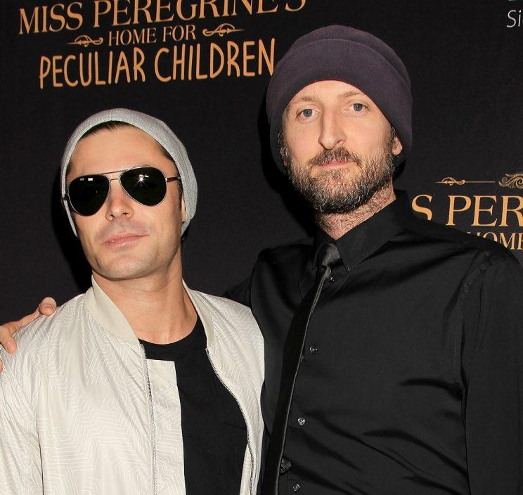 Michael Gracey, pictured here with Zac Efron, is directing