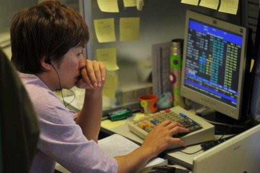 A trader works on a computer at the Hong Kong Stock Exchange
