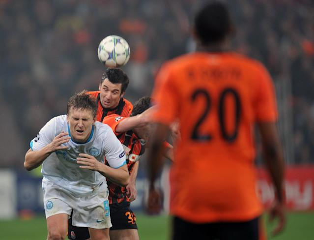 Razvan Rat (C) of FC Shakhtar fights for a ball with Aleksandr Bukharov (L ) of FC Zenit St Petersburg during UEFA Champions League, Group G football match in Donetsk on October 19, 2011. AFP PHOTO/ SERGEI SUPINSKY (Photo credit should read SERGEI SUPINSKY/AFP/Getty Images)