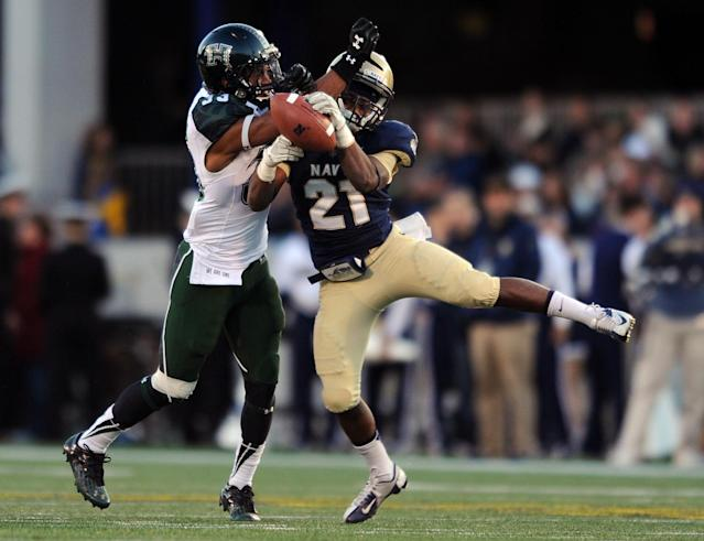 Navy's DeBrandon Sanders, right, catches a pass as Hawaii's John Hardy-Tuliau defends in the first half of an NCAA college football game on Saturday, Nov. 9, 2013, in Annapolis, Md .(AP Photo/Gail Burton)