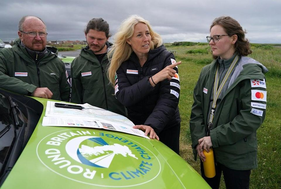 Paramotorist Sacha Dench (second right) with her team, including Dan Burton (left) (Andrew Milligan/PA) (PA Wire)