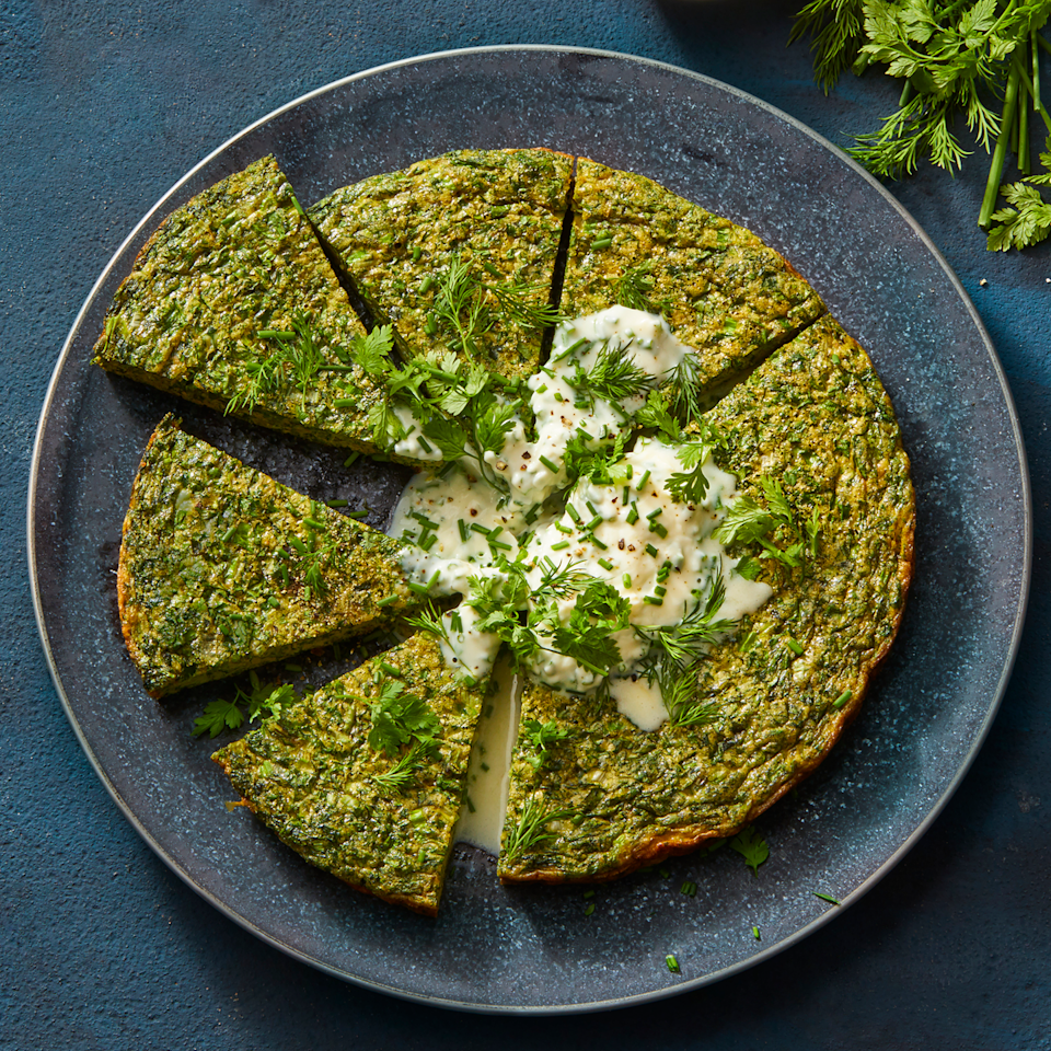 """<p>We bet you've never had a frittata <em>this</em> jam-packed with herbs before. Scallions, parsley, cilantro, and dill pack in tons of flavor (and nutrients), while eggs and crème fraîche act as a savory base.</p><p><a href=""""https://www.prevention.com/food-nutrition/recipes/a34894579/herb-frittata-recipe/"""" rel=""""nofollow noopener"""" target=""""_blank"""" data-ylk=""""slk:Get the recipe from Prevention»"""" class=""""link rapid-noclick-resp""""><strong><em>Get the recipe from Prevention»</em></strong></a></p>"""