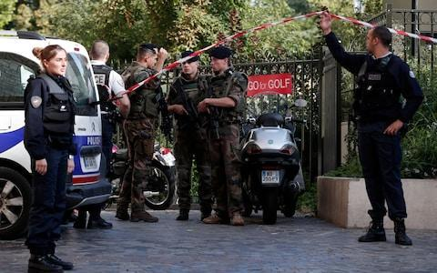 Police and soldiers secure the scene where French soliders were hit and injured by a vehicle in the western Paris suburb of Levallois-Perret - Credit: REUTERS/Benoit Tessier