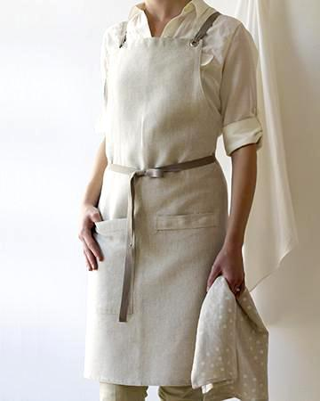 """<p> Weber says this bestselling linen apron is designed with cross-back ties for comfort and practicality—it's a customer favorite for a reason. """"The very adjustable cross-back ties eliminate any strain on the back of the neck, and the apron now hangs from the shoulders and hugs the upper body,"""" she explains. """"With gravity in play, you can tie the apron in front or in back, wear it tightly or loosely, and it stays in place.""""</p> <p><strong><em>Shop Now: </em></strong><em>Studio Patro Kitchen Apron, in Oatmeal, $84, </em><a href=""""https://studiopatro.com/collections/linen-aprons/products/kitchen-apron-oatmeal"""" rel=""""nofollow noopener"""" target=""""_blank"""" data-ylk=""""slk:studiopatro.com"""" class=""""link rapid-noclick-resp""""><em>studiopatro.com</em></a><em>. </em></p>"""