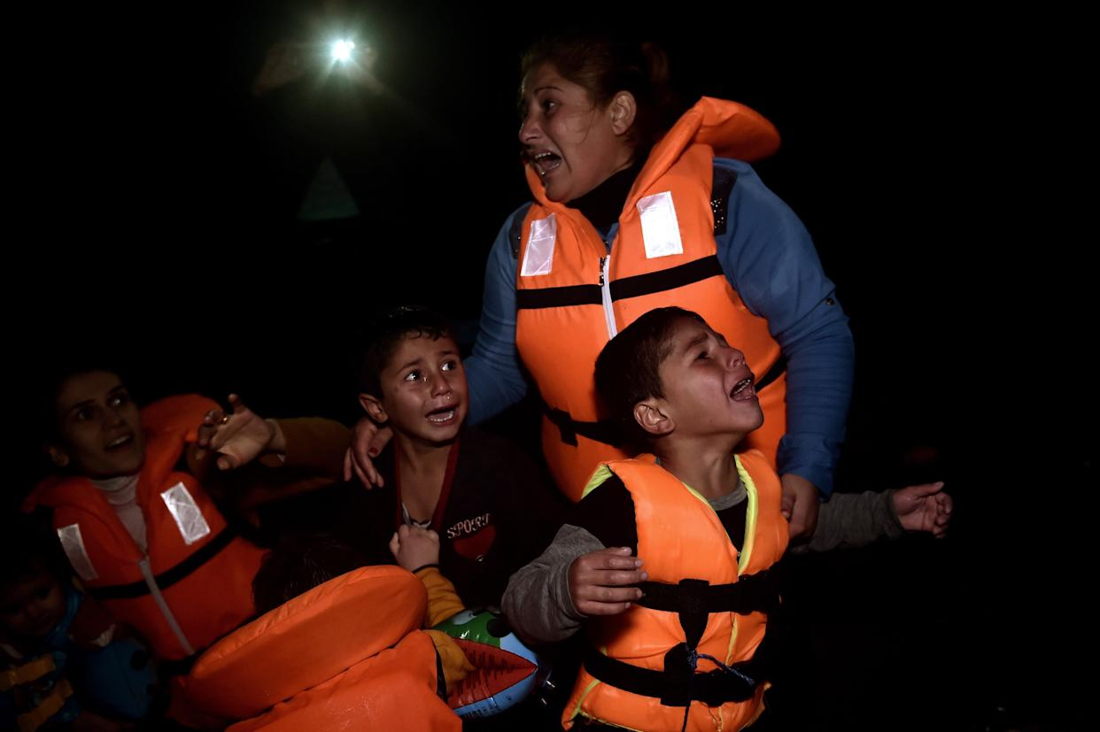 Refugees and migrants arrive at Lesbos island after crossing the Aegean sea from Turkey on October 27, 2015.