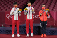 China's Chen Meng, center, holds her gold medal, China's Sun Yingsha, left, silver medal, and Japan's Mima Ito, bronze medal, pose for photographers in the table tennis women's singles at the 2020 Summer Olympics, Thursday, July 29, 2021, in Tokyo. (AP Photo/Kin Cheung)
