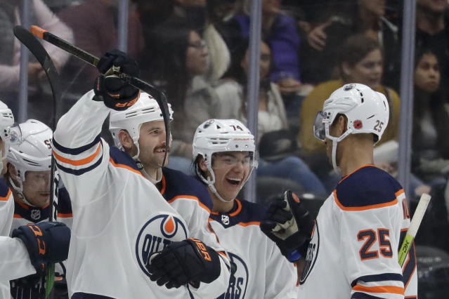 Edmonton Oilers right wing Zack Kassian, left, celebrates his goal with defensemen Darnell Nurse, right and Ethan Bear during the second period of an NHL hockey game against the Anaheim Ducks in Anaheim, Calif., Sunday, Nov. 10, 2019. (AP Photo/Chris Carlson)