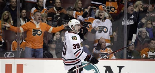 Chicago Blackhawks' Jimmy Hayes celebrates after scoring a goal as Philadelphia Flyers' fans react in the first period of an NHL hockey game on Thursday, Jan. 5, 2012, in Philadelphia. (AP Photo/Matt Slocum)