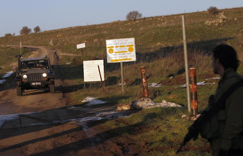 Israeli troops patrol the Israeli-occupied sector of the Golan Heights on January 18, 2015