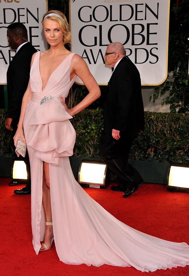 69th ANNUAL GOLDEN GLOBE AWARDS -- Pictured: Charlize Therone arrives at the 69th Annual Golden Globe Awards held at the Beverly Hilton Hotel on January 15, 2012 -- Photo by: Vince Bucci/NBC/NBCU Photo Bank