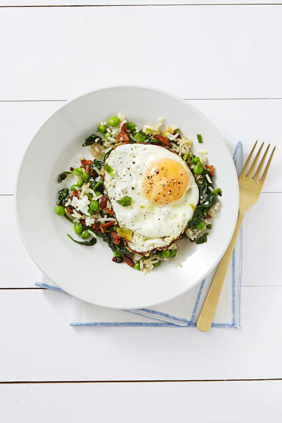 """<p>What's the key to getting brunch on the table fast? Starting with last night's leftovers (i.e. basic fried rice) ... and then adding <a href=""""https://www.goodhousekeeping.com/food-recipes/cooking/g4679/how-to-cook-bacon-in-the-oven/"""" rel=""""nofollow noopener"""" target=""""_blank"""" data-ylk=""""slk:bacon"""" class=""""link rapid-noclick-resp"""">bacon</a>. </p><p><em><a href=""""https://www.goodhousekeeping.com/food-recipes/a37557/bacon-egg-fried-rice-recipe/"""" rel=""""nofollow noopener"""" target=""""_blank"""" data-ylk=""""slk:Get the recipe for Bacon and Egg Fried Rice »"""" class=""""link rapid-noclick-resp"""">Get the recipe for Bacon and Egg Fried Rice »</a></em></p><p><strong>RELATED: </strong><a href=""""https://www.goodhousekeeping.com/cooking-tools/g25918220/best-egg-cookers/"""" rel=""""nofollow noopener"""" target=""""_blank"""" data-ylk=""""slk:The Best Egg Cookers to Buy Right Now, According to Kitchen Appliance Experts"""" class=""""link rapid-noclick-resp"""">The Best Egg Cookers to Buy Right Now, According to Kitchen Appliance Experts</a></p>"""