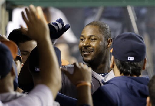 Houston Astros congratulate Chris Carter on his solo home run against the Los Angeles Angels in the fifth inning of a baseball game in Anaheim, Calif., Monday, June 3, 2013. (AP Photo/Reed Saxon)