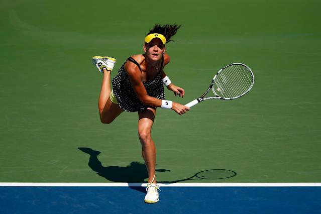 Agnieszka Radwanska of Poland serves against Shuai Peng of China during the 2014 US Open on August 27, 2014 in the Queens borough of New York City (AFP Photo/Julian Finney)
