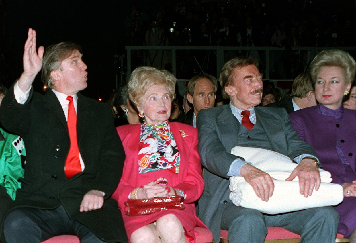 Donald Trump waves to staff members of the Trump Taj Mahal Casino Resort as they cheer him on before the grand opening ceremonies in Atlantic City, N.J., in April 1990. Trump attended the gala with his mother, Mary; his father, Fred; and his sister Maryanne Trump Barry. (AP Photo/Charles Rex Arbogast)