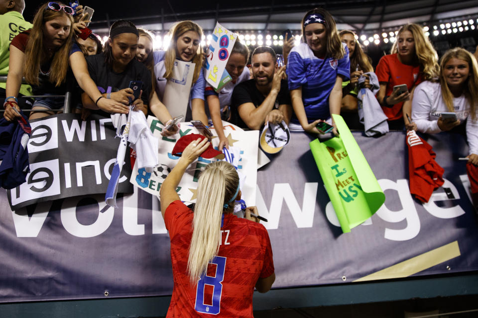 United States' Julie Ertz signs autographs for fans after the team's international friendly soccer match against Portugal on Thursday, Aug. 29, 2019, in Philadelphia. The United States won 4-0. (AP Photo/Matt Slocum)