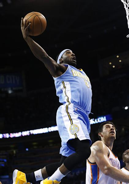 Denver Nuggets guard Ty Lawson (3) shoots in front of Oklahoma City Thunder forward Nick Collison (4) in the second quarter of an NBA basketball game in Oklahoma City, Tuesday, March 19, 2013. (AP Photo/Sue Ogrocki)
