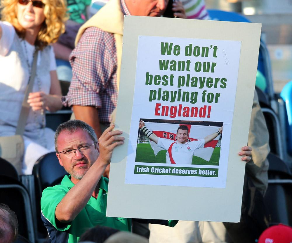 MALAHIDE, IRELAND - SEPTEMBER 03:  A spectator makes a protest during the RSA Challenge One Day International match between Ireland and England on September 3, 2013 in Malahide, Ireland.  (Photo by Clive Rose/Getty Images)