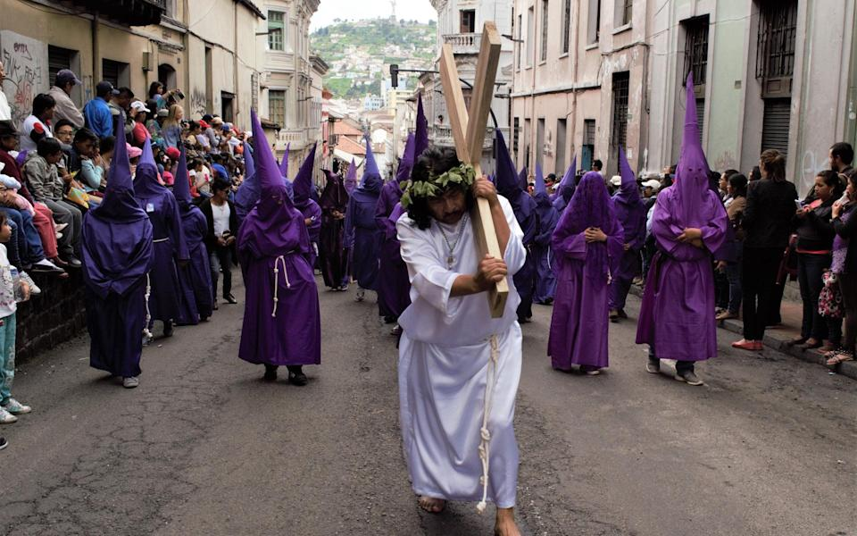 Cucuruchos during the Easter procession in Quito - Getty