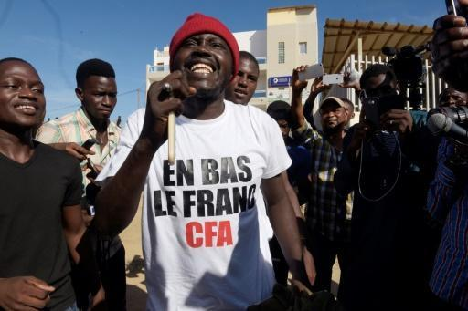 Senegal acquits activist for burning cash in anti-colonial protest