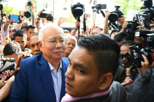 Malaysia's former prime minister Najib Razak had to navigate a media scrum when he arrived at the anti-graft agency for questioning over a massive financial scandal