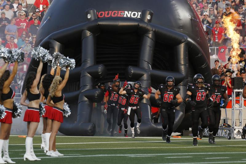 Ottawa Redblacks players take to the field before their CFL football game against the Toronto Argonauts in Ottawa
