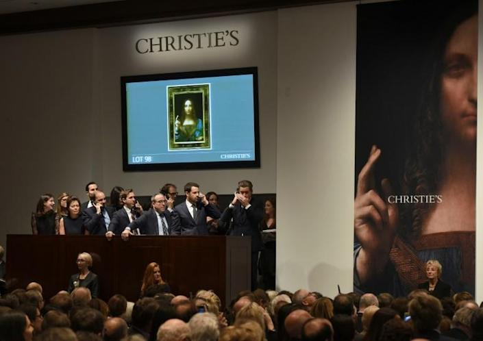 Salvator Mundi, attributed to Leonardo da Vinci, sold for $450 million euros at a 2017 Christie's auction (AFP Photo/TIMOTHY A. CLARY)