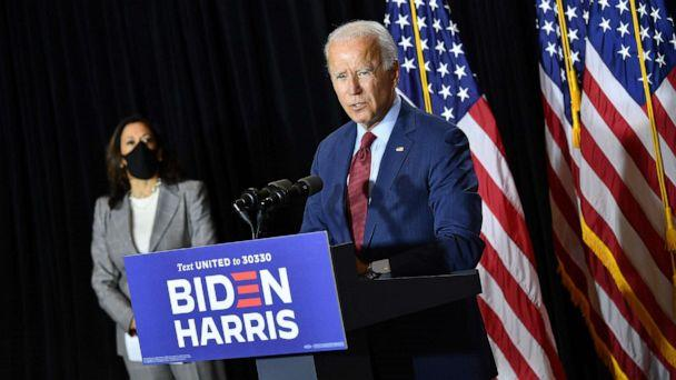 PHOTO: Democratic presidential nominee, former Vice President Joe Biden (R), and vice presidential running mate, US Senator Kamala Harris, hold a press conference after receiving a briefing on COVID-19 in Wilmington, Del., Aug. 13, 2020.  (Mandel Ngan/AFP via Getty Images)