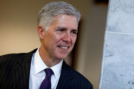 FILE PHOTO - Supreme Court nominee Neil Gorsuch on Capitol Hill in Washington