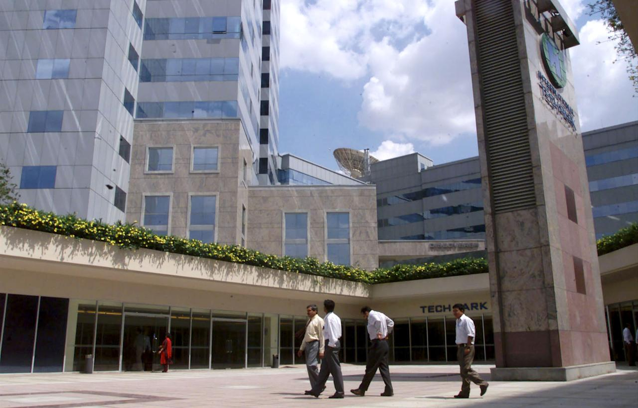 A few software programmers walk out of the International Technology Park Ltd building which houses nearly 50 technology firms in Bangalore.