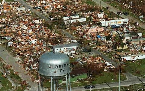 A water tower stands over the ruins of the coastal community of Florida City.