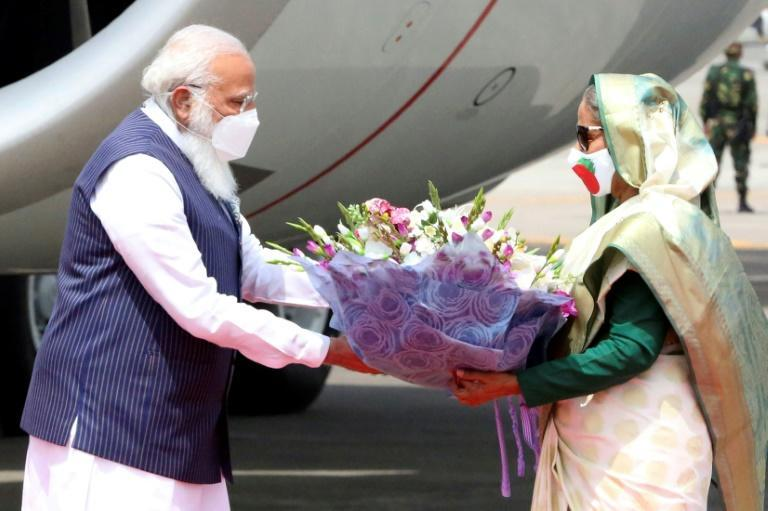 Prime Minister Sheikh Hasina (right) greets Indian Prime Minister Narendra Modi ahead of Independence Day celebrations