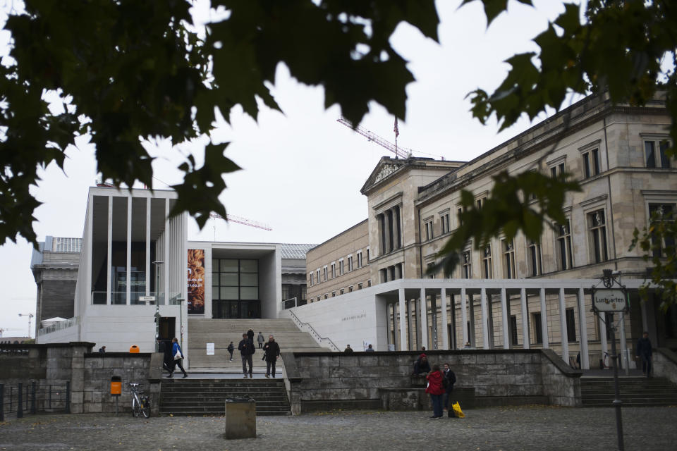 The main entrance to the Museums Island and the Neue Museum, left, in Berlin, Wednesday, Oct. 21, 2020. A large number of art works and artifacts at some of Berlin's best-known museums were smeared with a liquid by an unknown perpetrator or perpetrators earlier this month, police said Wednesday. The 'numerous' works in several museums at the Museum Island complex, a UNESCO world heritage site in the heart of the German capital that is one of the city's main tourist attractions, were targeted between 10 a.m. and 6 p.m. on Oct. 3, police said. (AP Photo/Markus Schreiber)